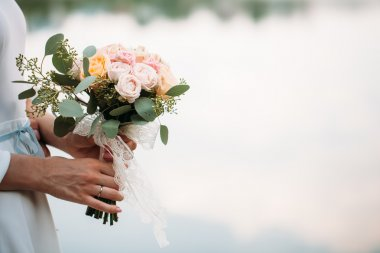 wedding bouquet of flowers in hands