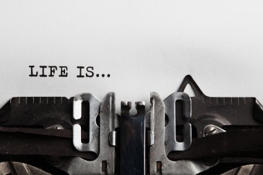 Life is sign with typewriter