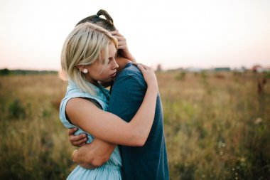 couple hugging outdoor in the field, summertime