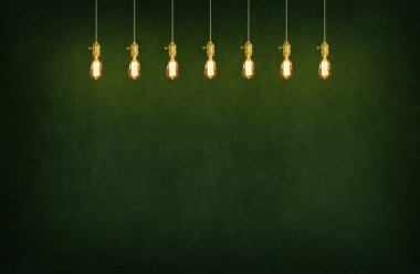 room with pendant lamps and blackboard background