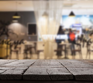Coffee shop blurred background with bokeh and wooden floor