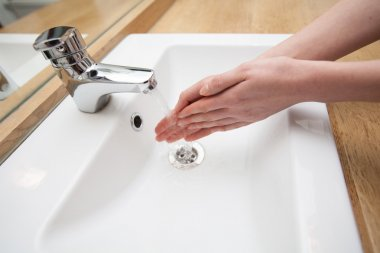 Woman washing Hands. Cleaning Hands