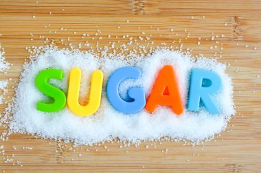 word Sugar on granulated sugar