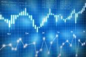 akciový trh svíčkový graf na modrém pozadí