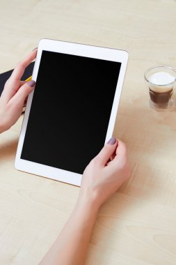 Woman holds mobile tablet