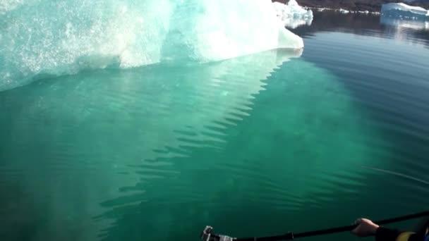 Small Iicebergs floating in sea around  Greenland.