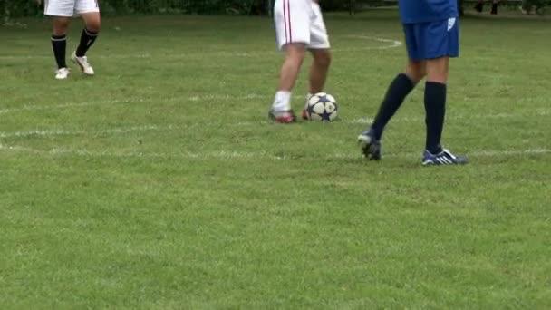 Asijské a evropští fotbalisté, aby hra během firemních akcí.