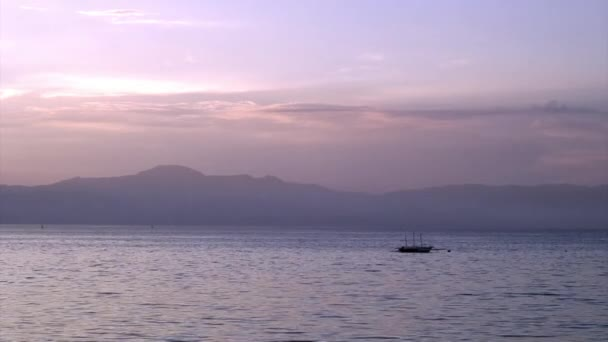Bright purple sunset over sea on islands of Republic of Philippines.