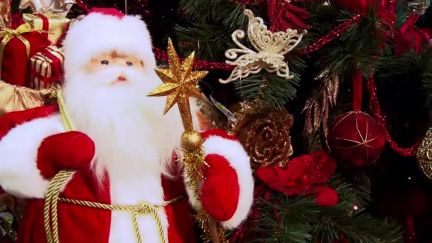 Christmas screen savers. Santa Claus under the Christmas tree. Glittering lights.