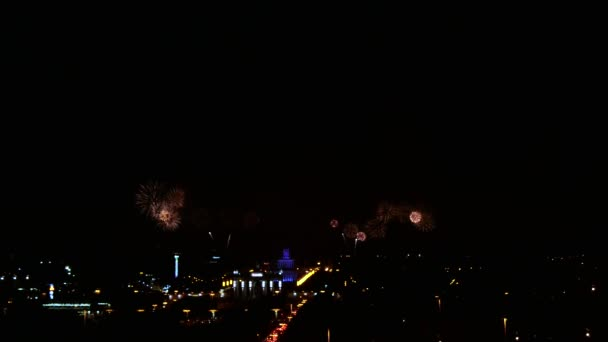 A beautiful pyro show fireworks in the big city in the night sky.