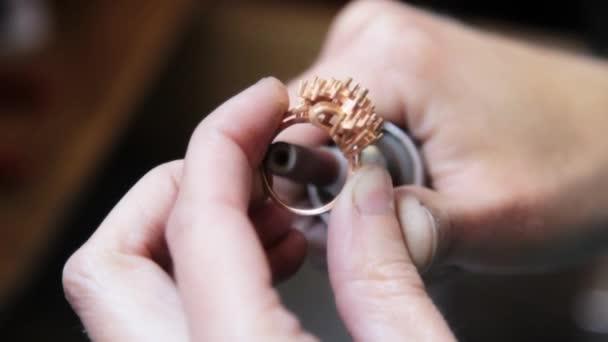 Hand polishing gold jewelry ring jeweler.