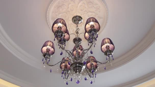 Beautiful crystal chandelier on the ceiling.