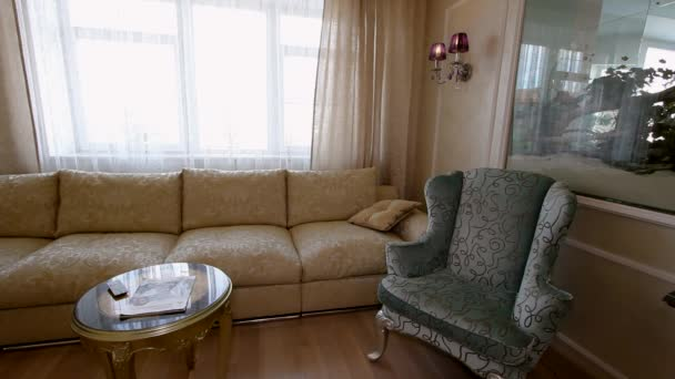 Day room with TV, karaoke, sofas and piano.
