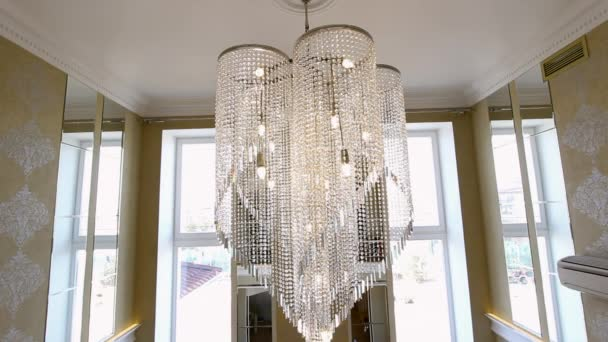 A large crystal chandelier on the ceiling.