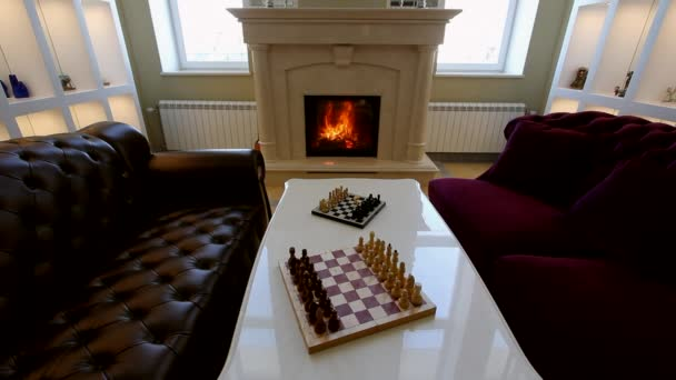 Panorama room with sofas, a fireplace and chess.