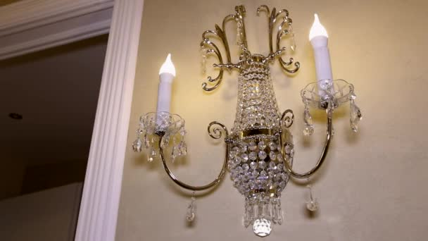 Chandelier in the form of candles on the wall.