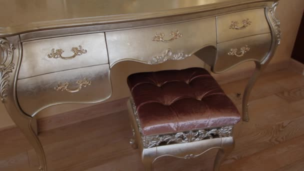 Bedroom with a large bed and a dressing table.
