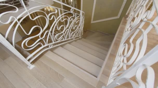 The staircase with wrought iron railing.