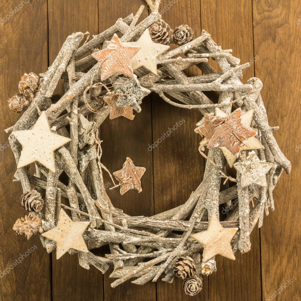 Christmas decoration with twigs, brown pine cone and wooden star– stock image