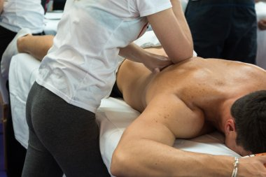 Athlete's Back Massage after Fitness Activity, Wellness and Spor