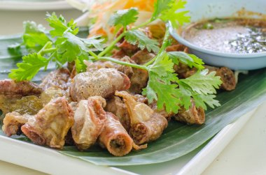 Chitterlings Fried garlic on white back ground,
