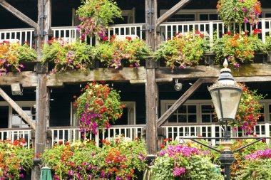 Big old house with hanging baskets