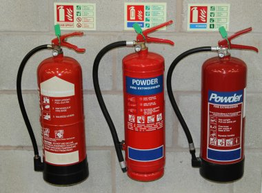 Three Fire Extinguishers