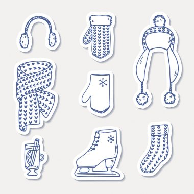 Set of winter stickers. Hand drawn outline knitted accessories. Cute clip art