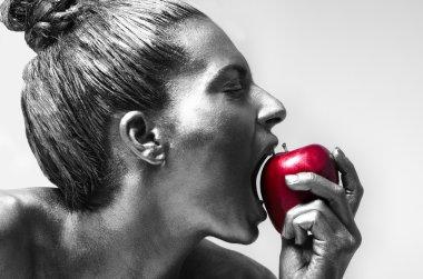 Woman biting Red Apple