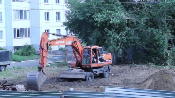 crazy excavator uproots huge tree