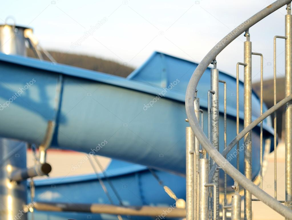 Detail Of Spiral Stairs To Blue Water Slide At Sunset U2014 Photo By CobraCZ