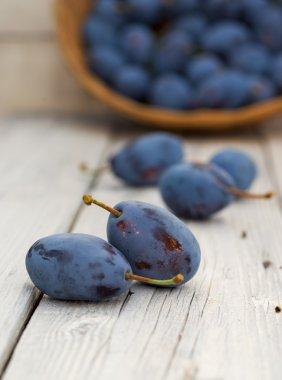 Bio plums on wood table
