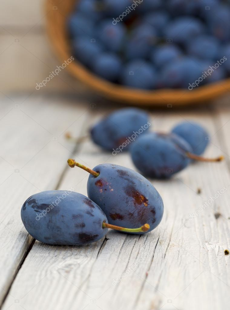 Bio plums on wood table