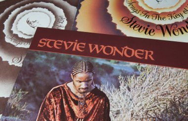 Viersen, Germany - May 9. 2020: Closeup of vinyl record covers from us american soul music singer Stevie Wonder (focus on singers name in center)