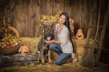 German Shepherd and Beautiful Witch on Halloween