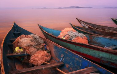 Colorful scenic sunset with fishing boats