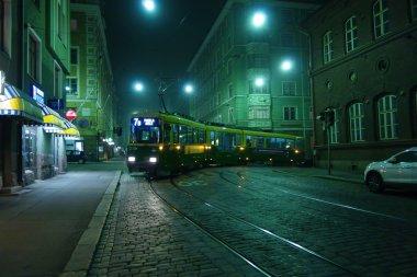 Tram in the foggy street