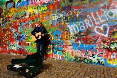 Busker by the John Lennon Wall in Prague