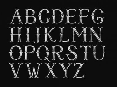 Alphabet hand-drawn on chalkboard