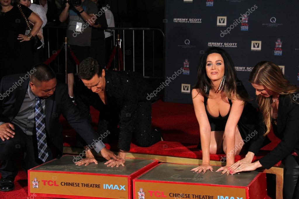 HOLLYWOOD - SEP 08: Jeremy Scott, Katy Perry at the Jeremy Scott and Katy Perry Handprints in Cement Ceremony, TCL Chinese Theater, Hollywood, CA stock vector