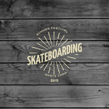 Skateboard badges logos and labels for any use, on wooden background texture stock vector
