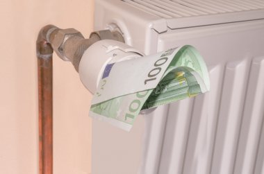 Thermostat with 100 euro. Heating costs concept.