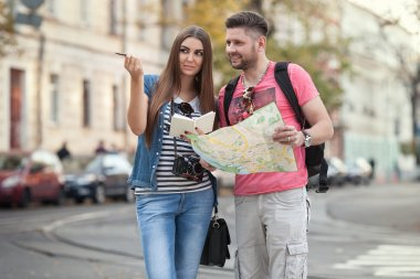 tourists with a map of the city