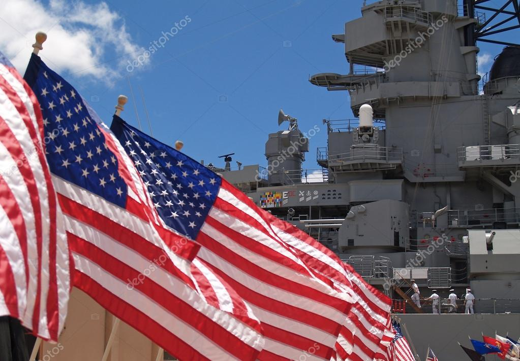 US Flags Flying Beside the Battleship Missouri Memorial, with Four Sailors