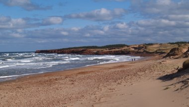 A beach with waves rolling in on Prince Edward Island.