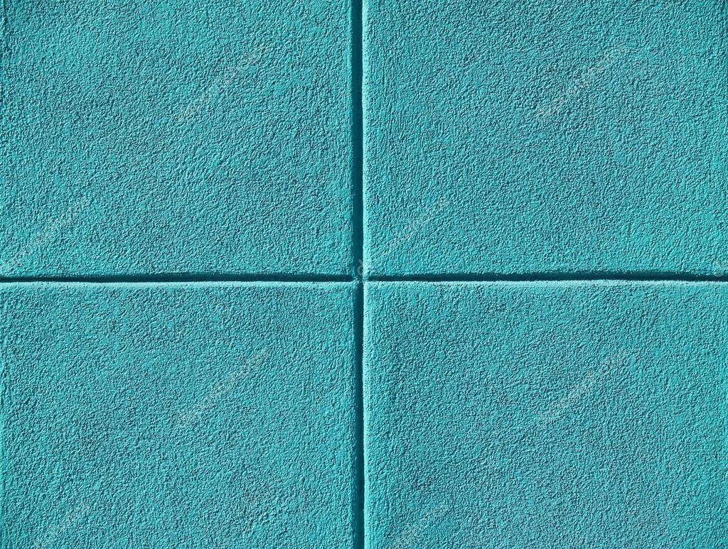 Four Teal Or Aqua Blue Squares On A Concrete Wall, Powerpoint Background  And Copy Space