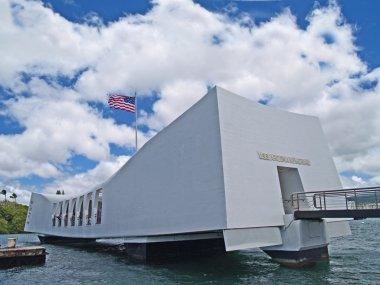 US Flag flying above the USS Arizona Memorial in Pearl Harbor, Honolulu, Hawaii.