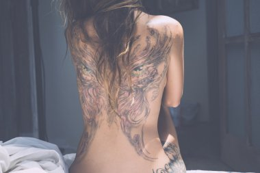 back of a young girl with a tattoo