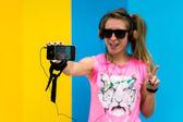 Fotografie  blonde girl doing a selfie