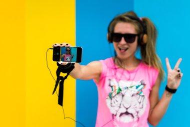 blonde girl doing a selfie